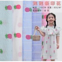 童装涤棉提花泡泡条印花连衣裙面料春夏儿童贴身布料